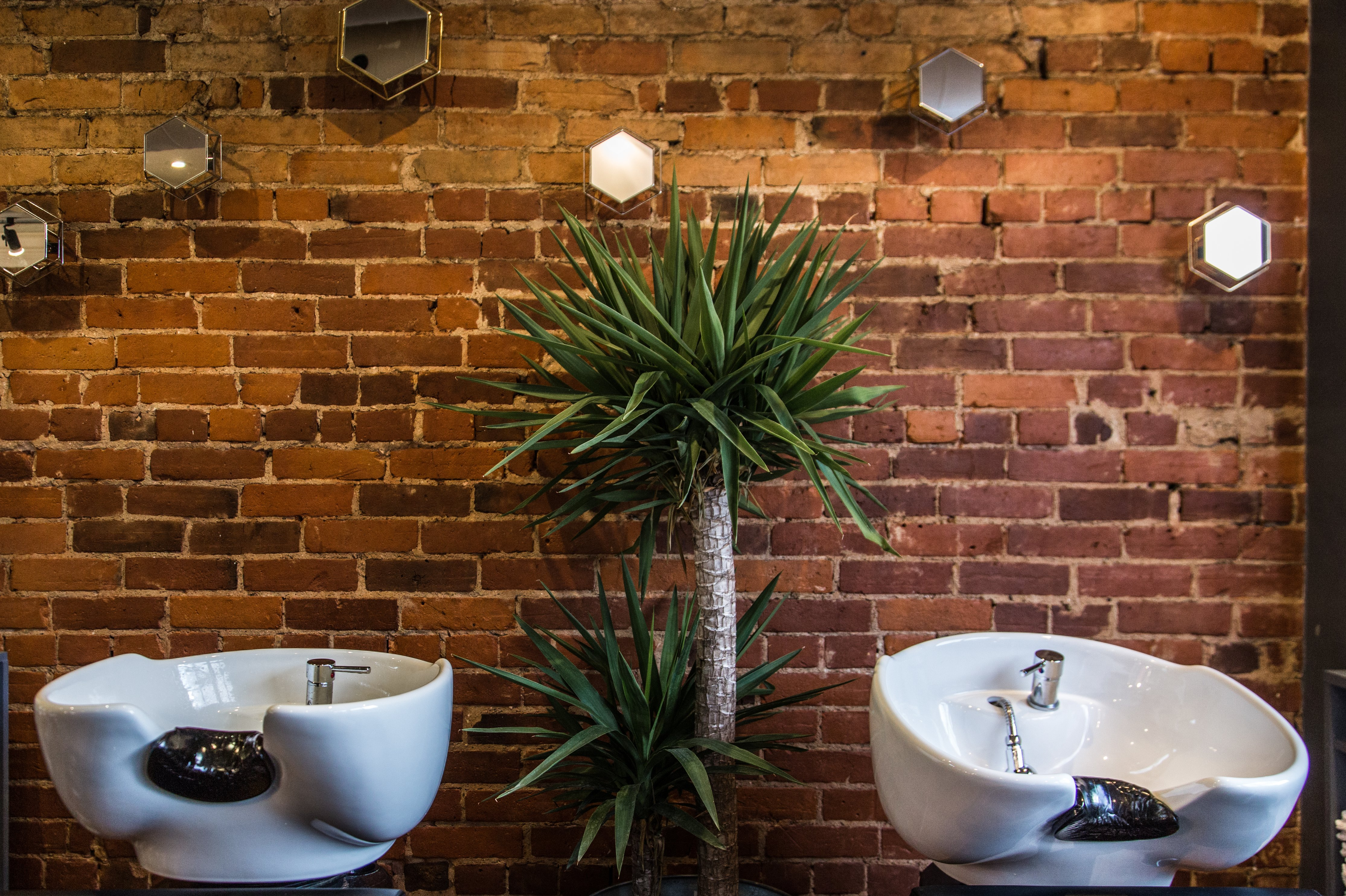 hair-salon-sinks-on-red-brick